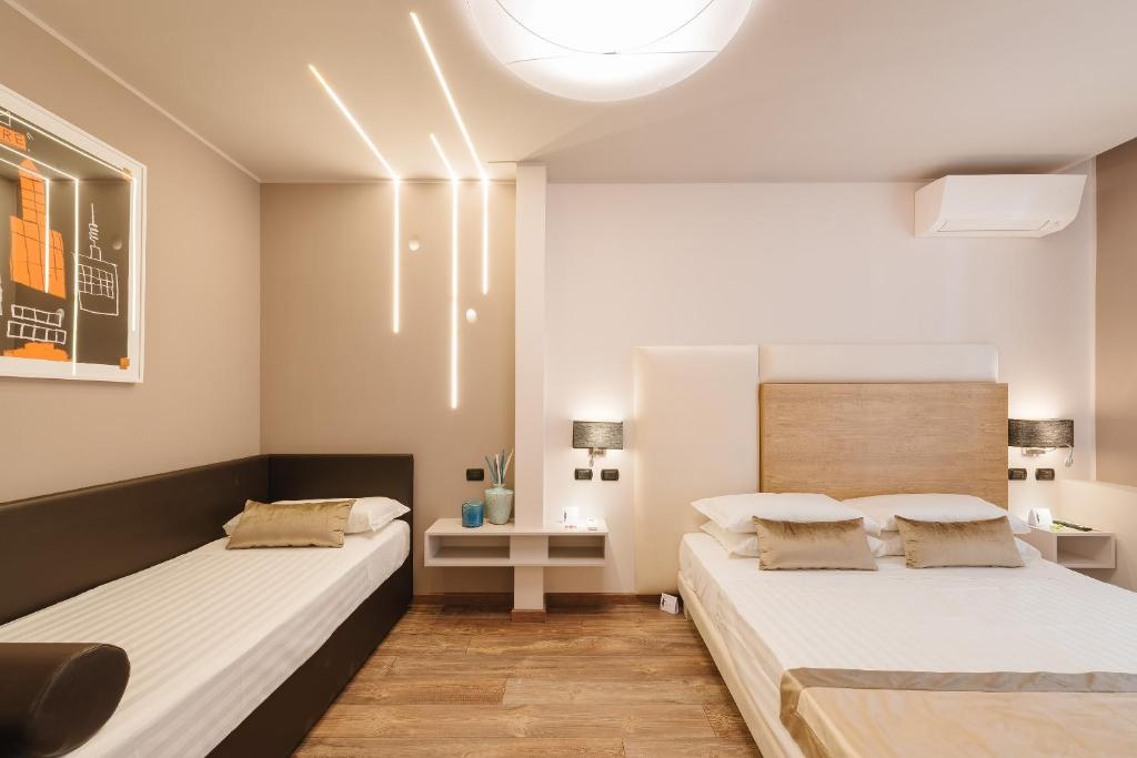 A bed or beds in a room at Rhea Silvia luxury Trastevere 2