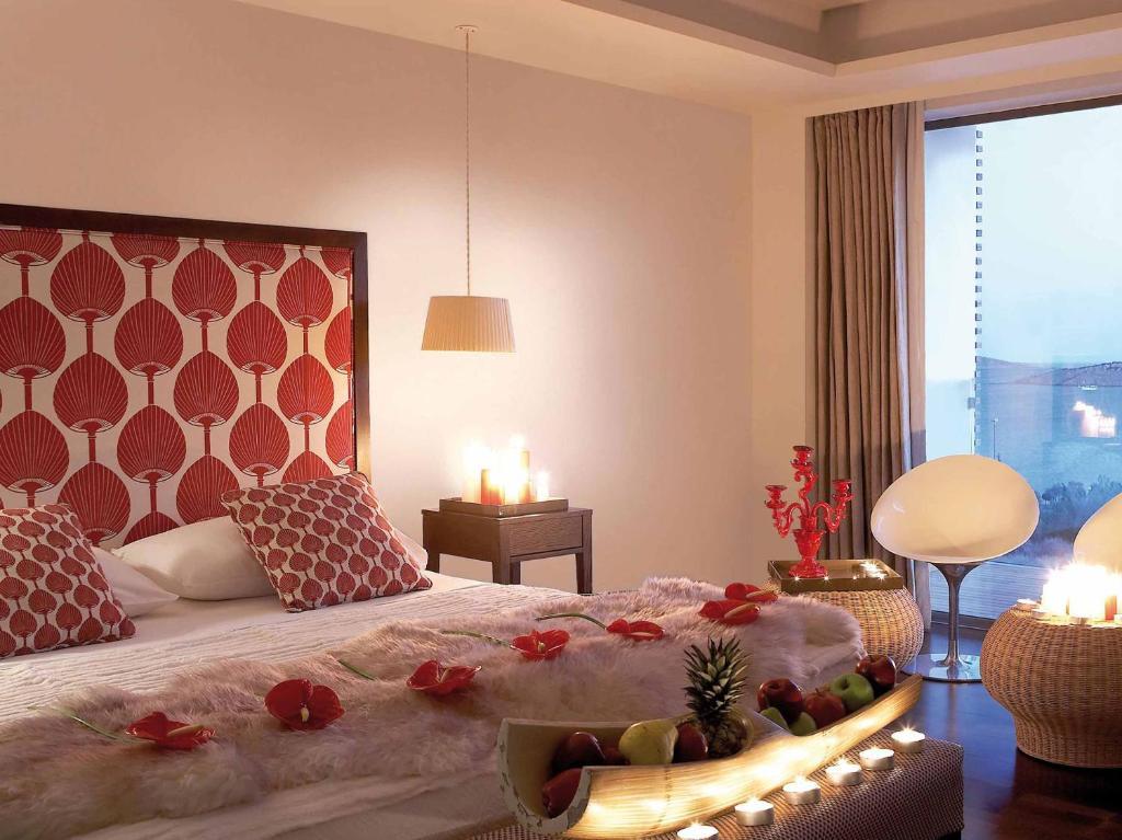 מיטה או מיטות בחדר ב-Vouliagmeni Suites