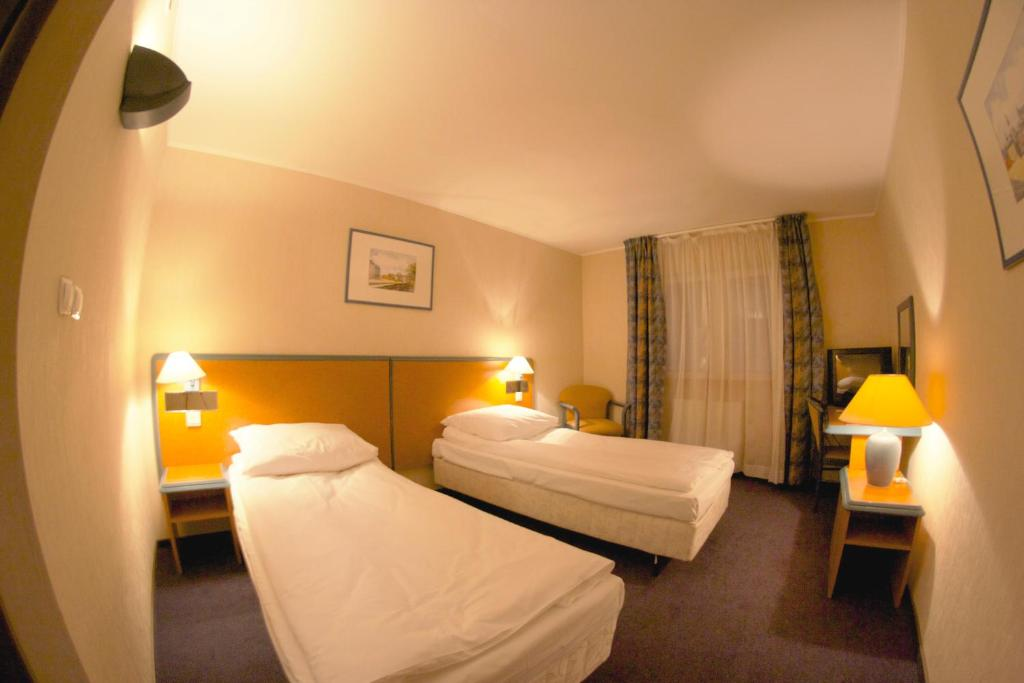 A bed or beds in a room at Hotel TenisHouse