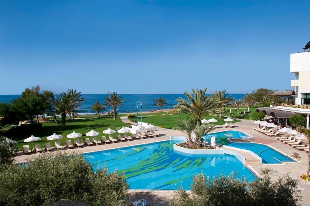 A view of the pool at Constantinou Bros Athena Royal Beach Hotel or nearby