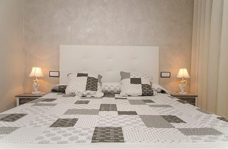 Cama o camas de una habitación en Hostal Don Rodrigo
