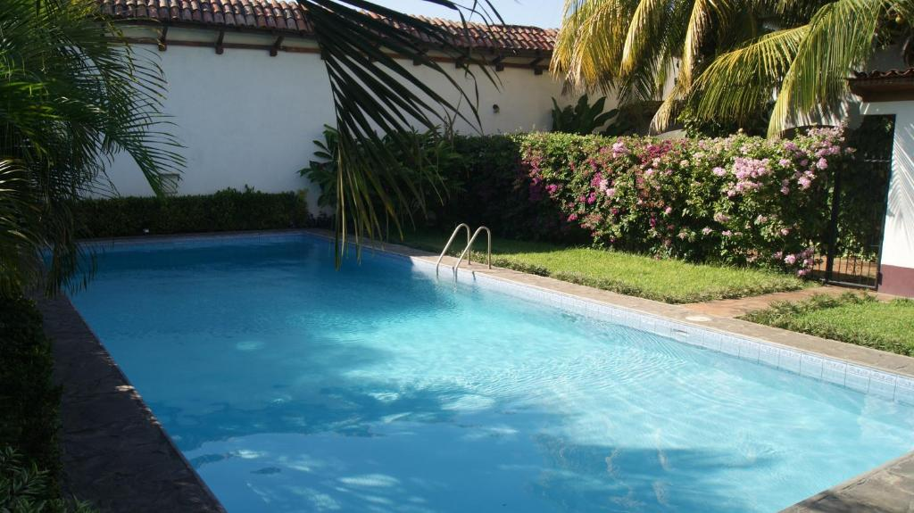 The swimming pool at or near Hotel Cacique Adiact