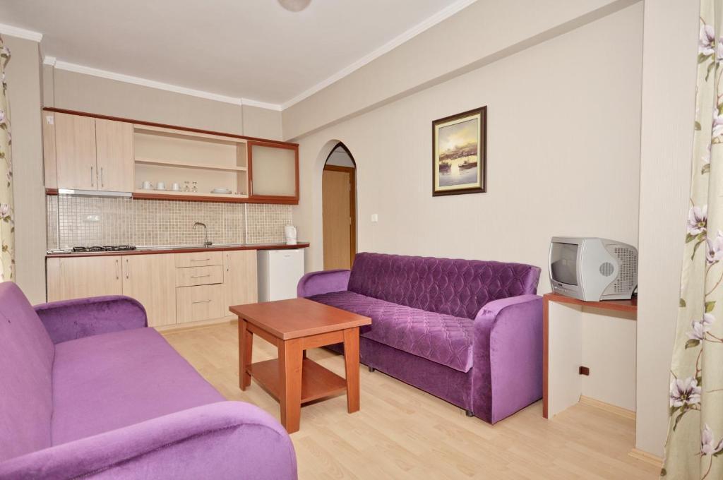 Гостиная зона в Bella Bravo Suit Hotel