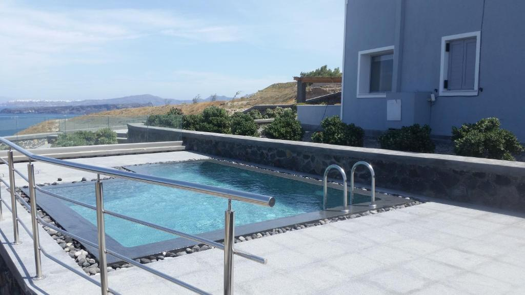 The swimming pool at or near Our Villa Santorini
