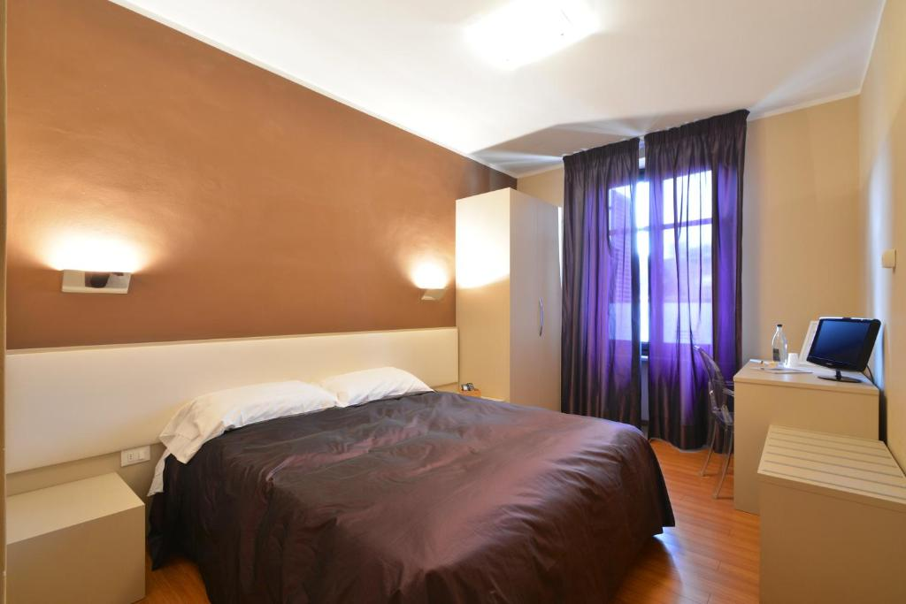 A bed or beds in a room at Matteotti25