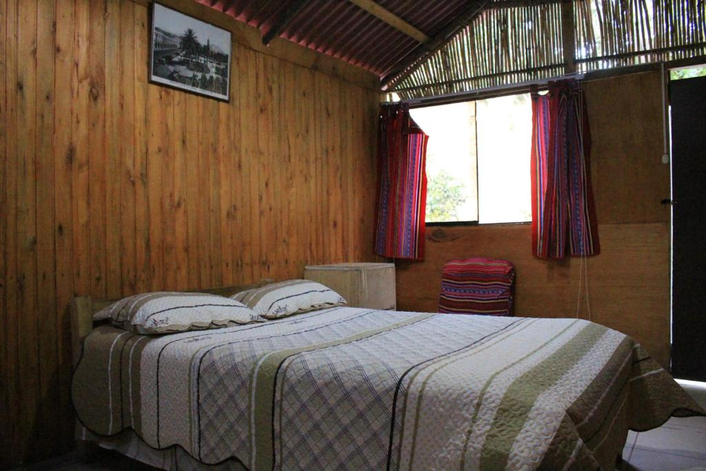 A bed or beds in a room at Oasis Paraiso Ecolodge