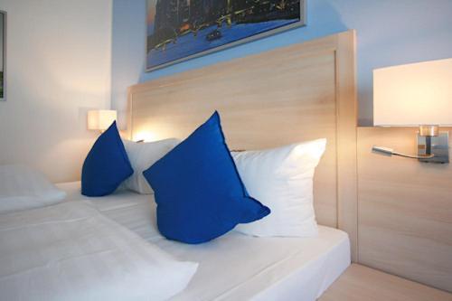 Ein Bett oder Betten in einem Zimmer der Unterkunft Hotel Römer