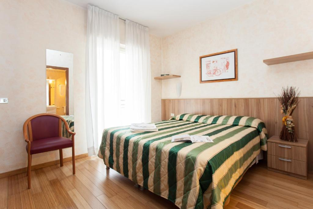 A bed or beds in a room at Residence Desenzano