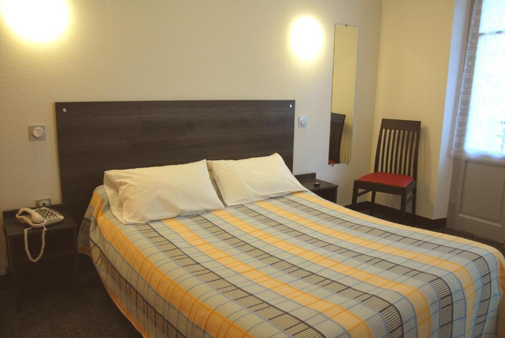 Un ou plusieurs lits dans un hébergement de l'établissement Hotel Printania