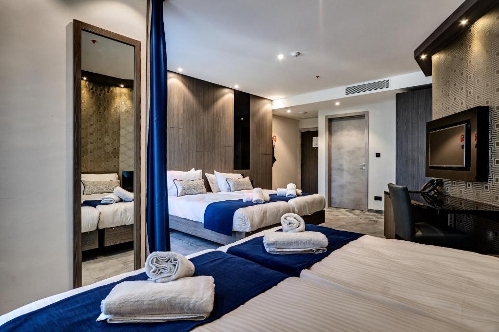 Cama o camas de una habitación en The District Hotel