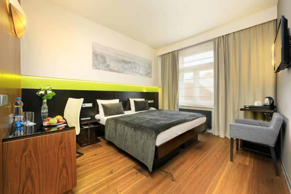 A bed or beds in a room at Ametyst Hotel Praha