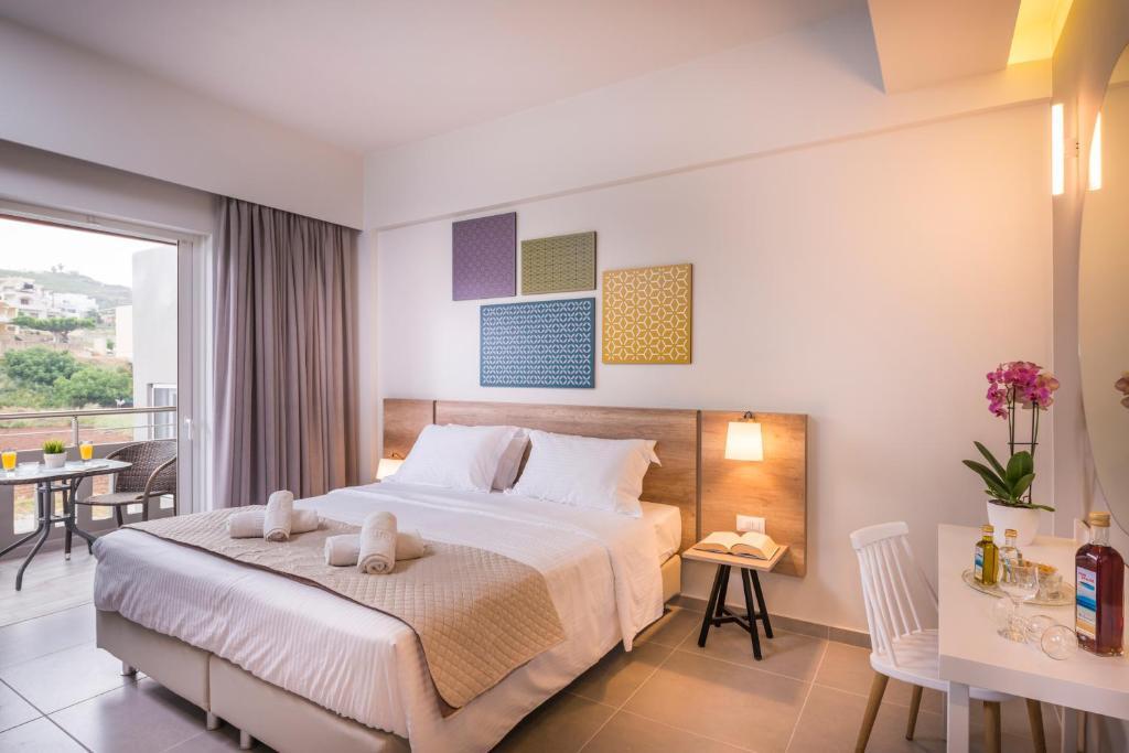 Ένα ή περισσότερα κρεβάτια σε δωμάτιο στο Irini Stalos Apartments