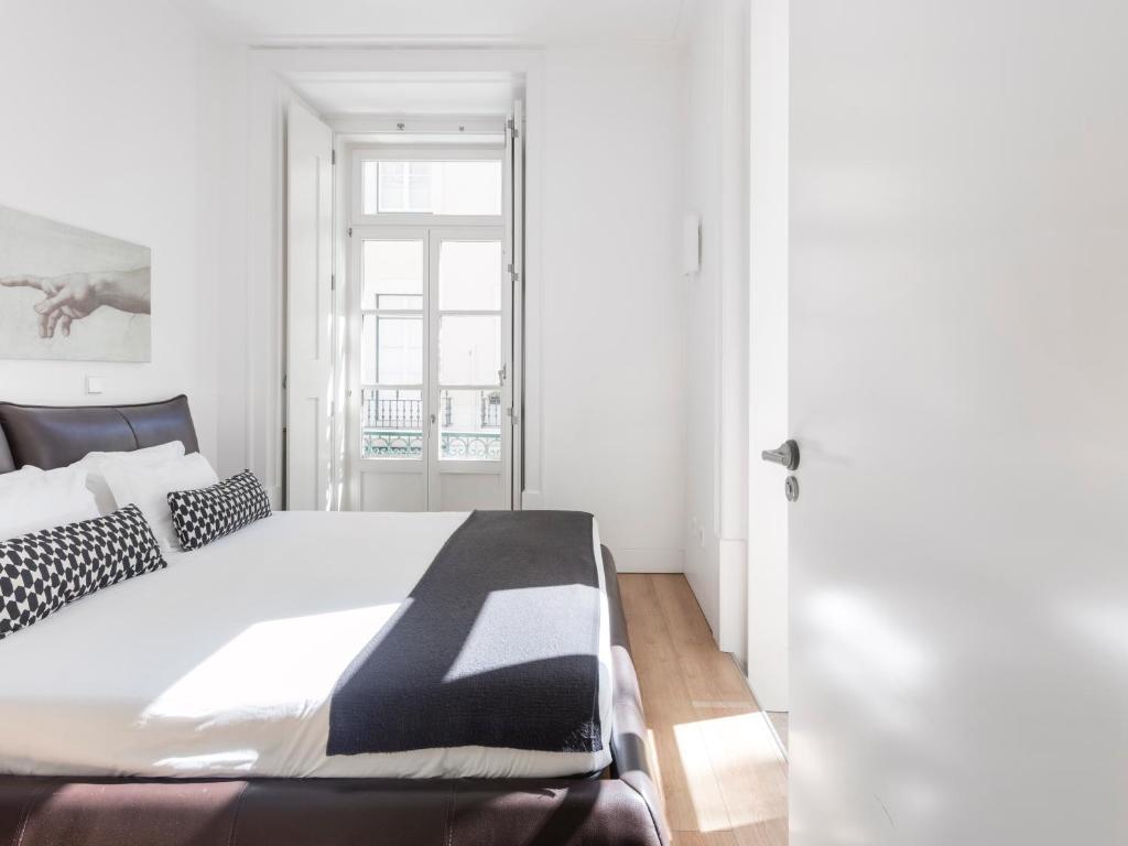 Uma cama ou camas num quarto em Lisbon Serviced Apartments - Baixa