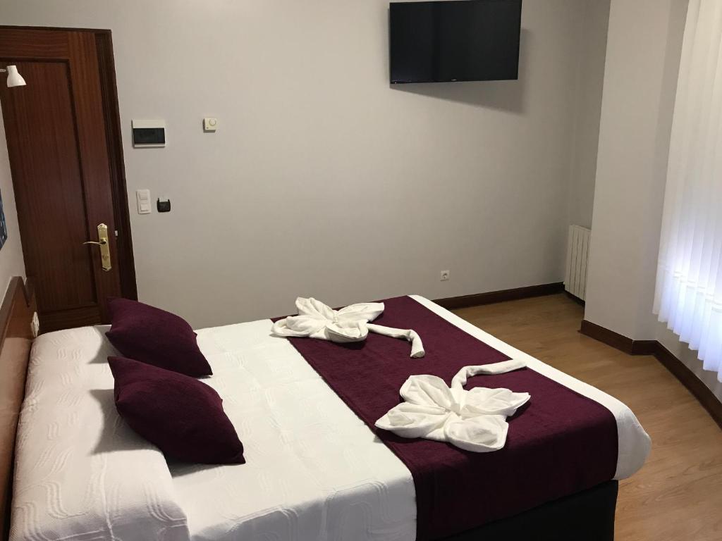 Cama o camas de una habitación en Pensión La Salve