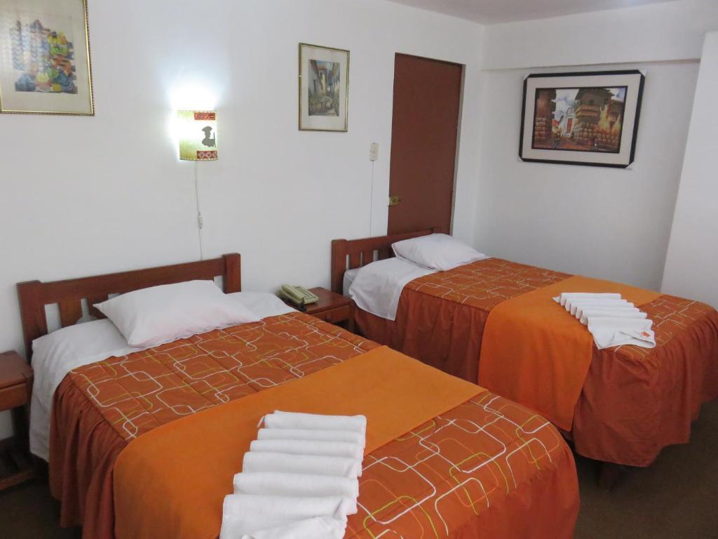 Cama o camas de una habitación en Dennys House Cusco