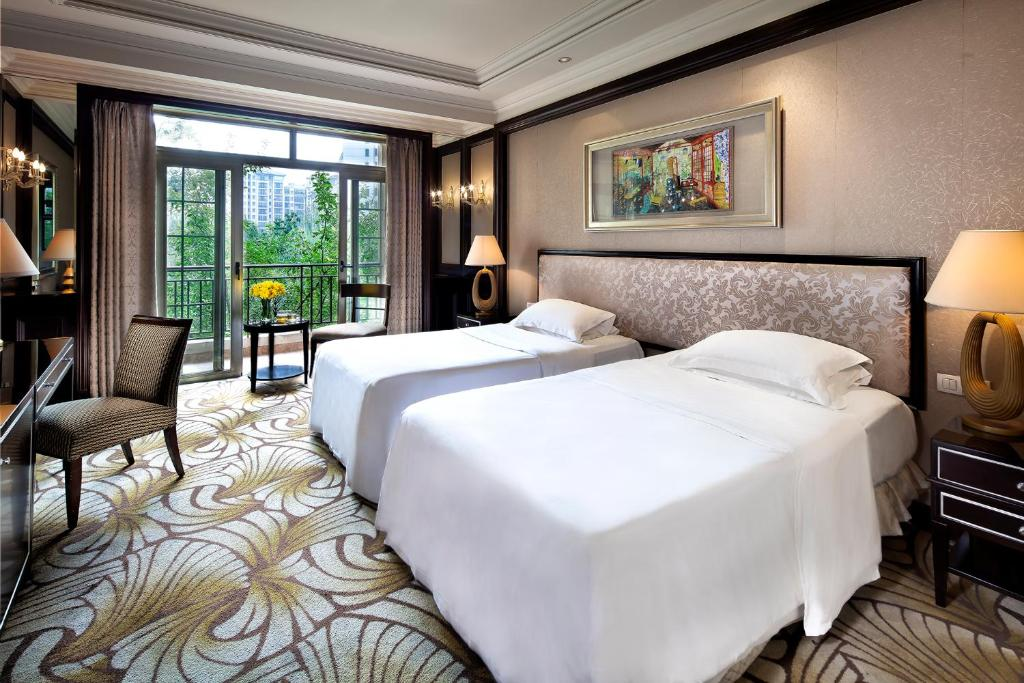 A bed or beds in a room at Chateau Star River