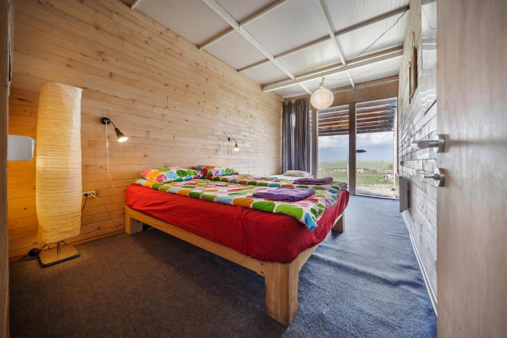 A bed or beds in a room at Oasis Club Cottages