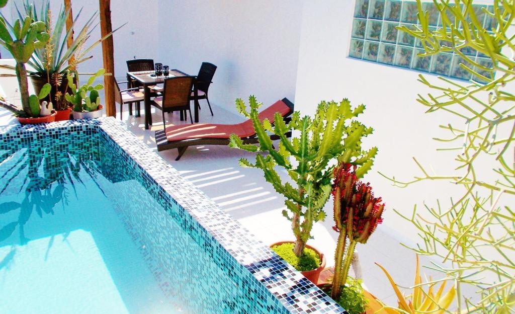 The swimming pool at or near Casa Naaj Apartments