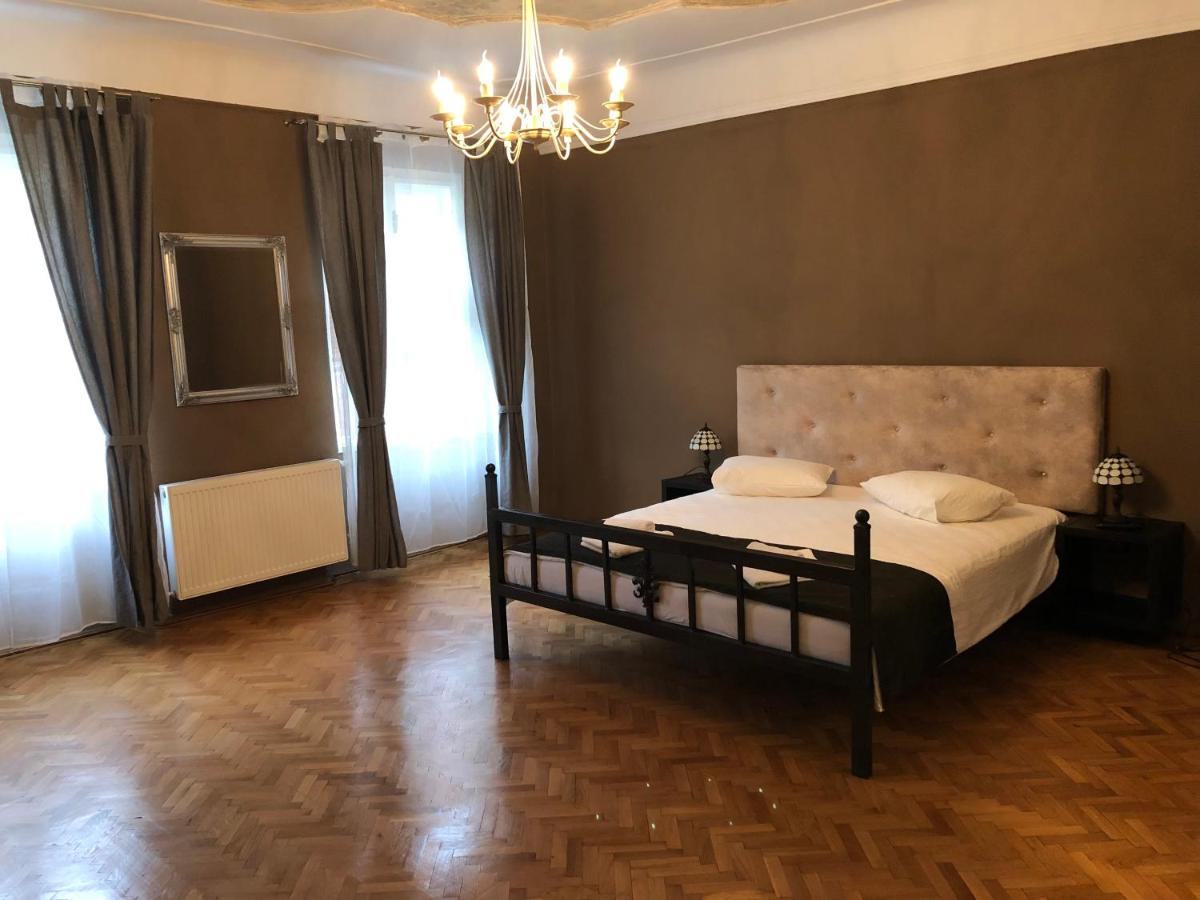 A bed or beds in a room at Poet Pastior Residence