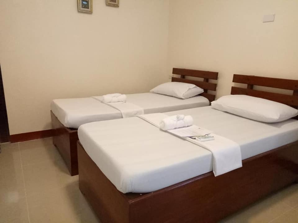 Мини-гостиница  AJ Travellers Inn - Annex