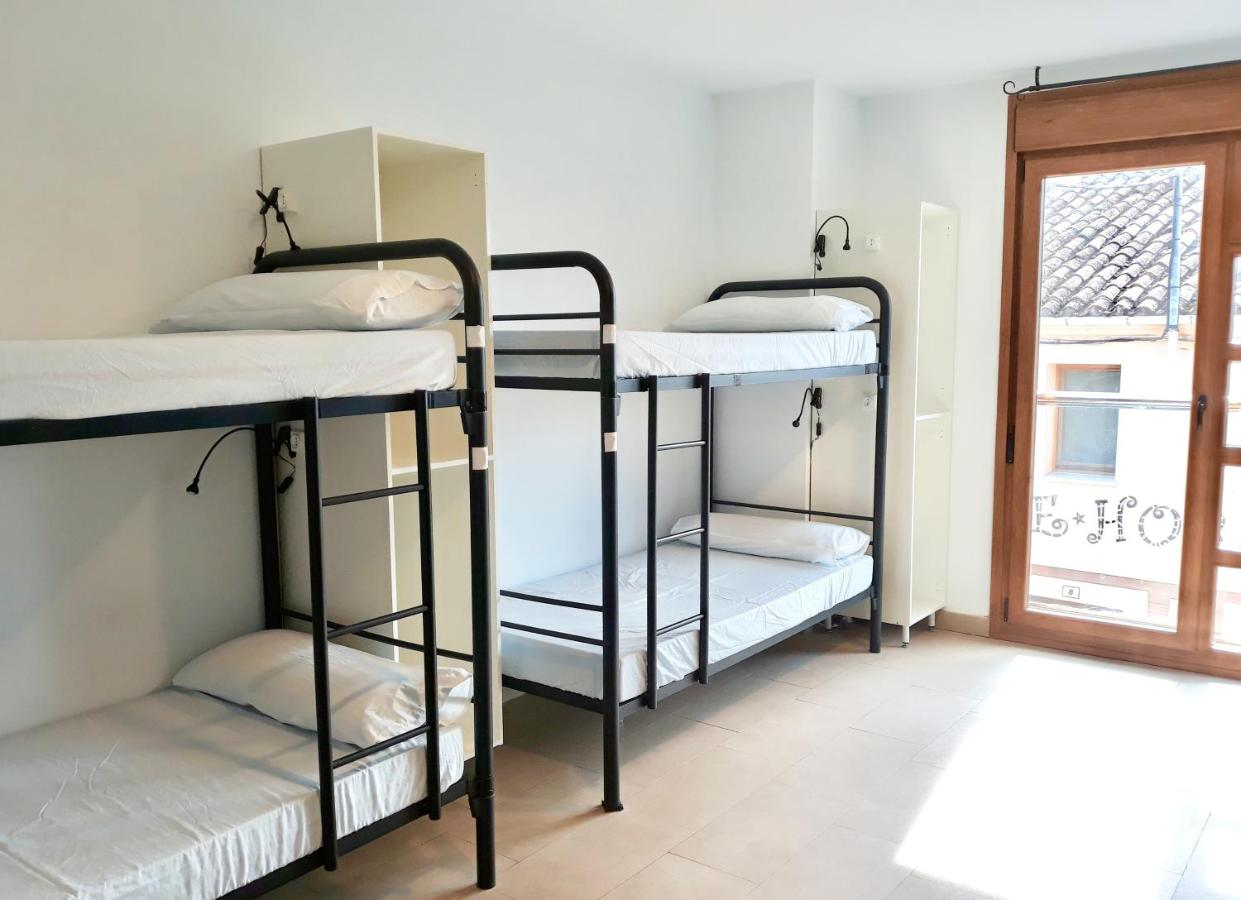 A bunk bed or bunk beds in a room at Hornillos Meeting Point (Pilgrim Hostel)