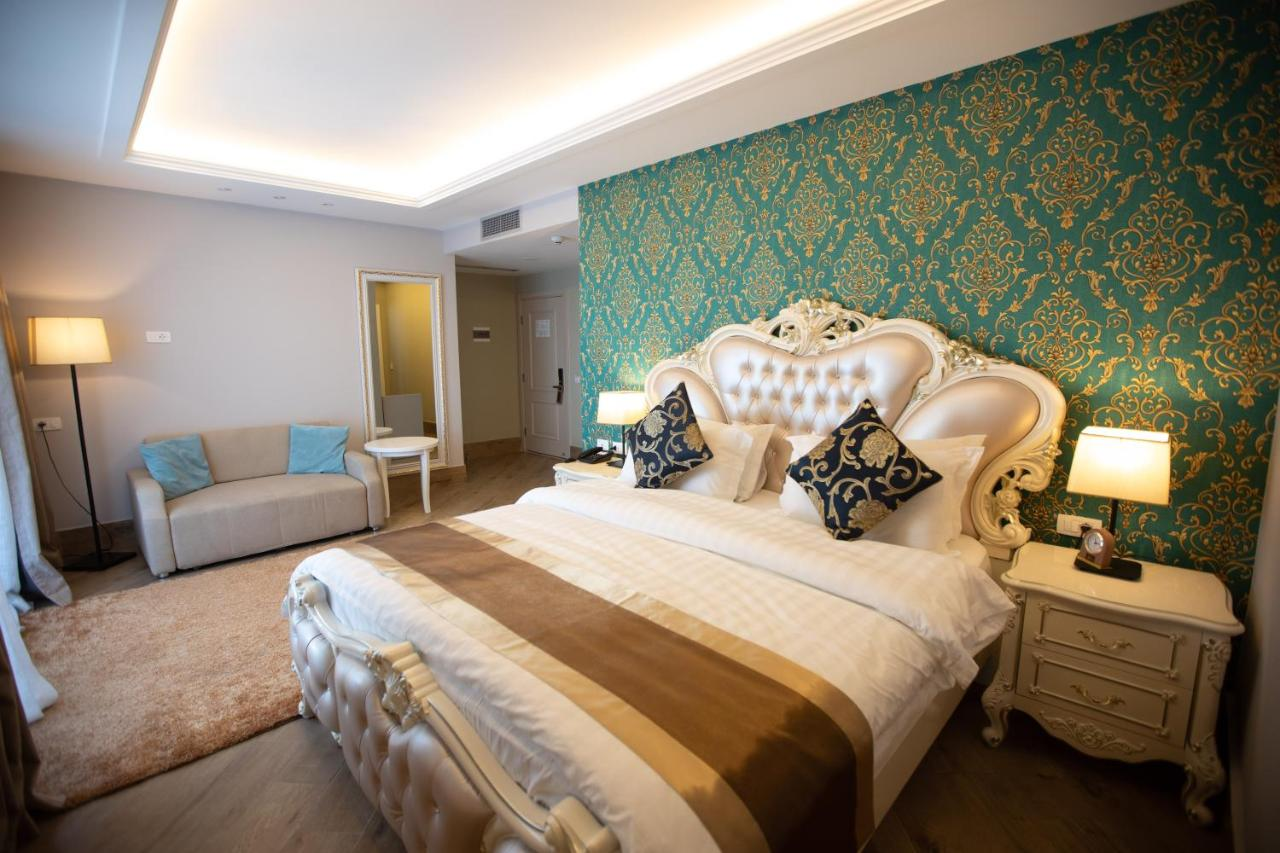 Ліжко або ліжка в номері Grand Blue Fafa Resort