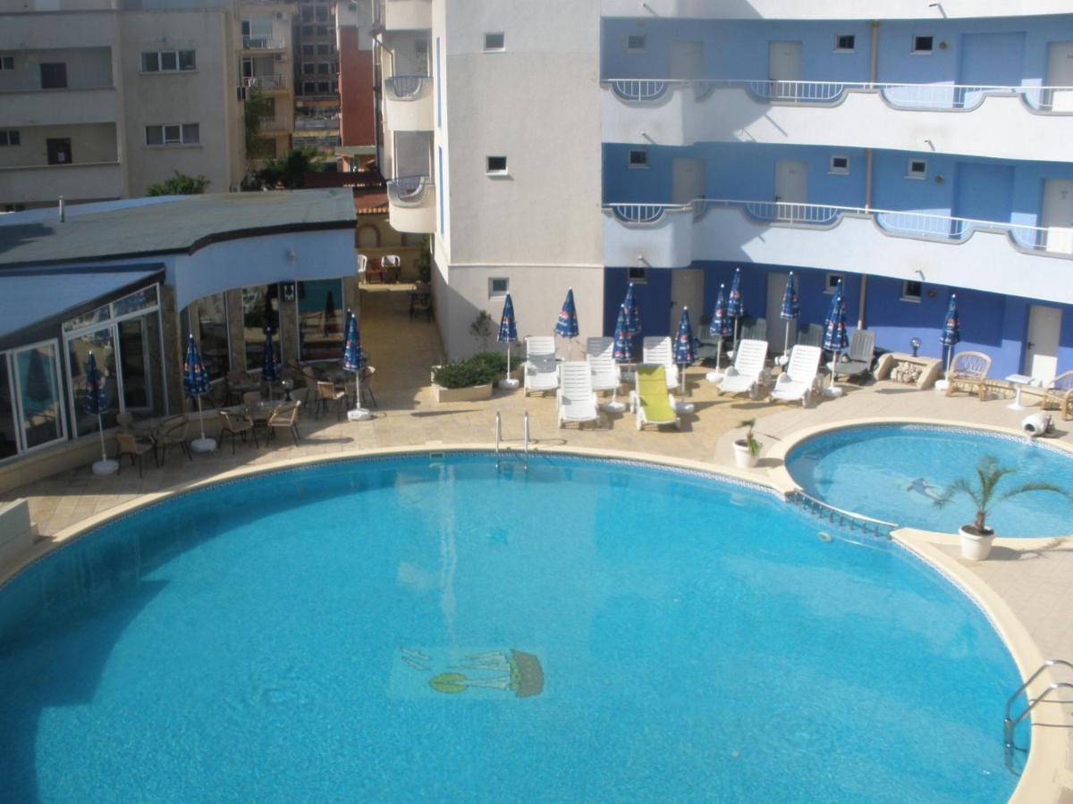 Отель Atos Hotel