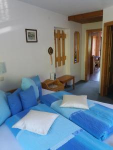 מיטה או מיטות בחדר ב-Haus Raimund