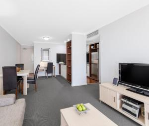 A television and/or entertainment center at Oaks Brisbane Lexicon Suites