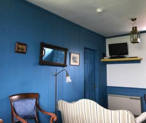 A television and/or entertainment center at The Keepers Cottage