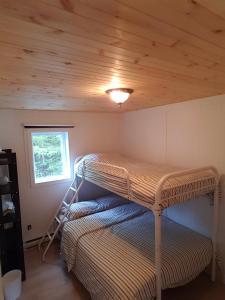 Un ou plusieurs lits superposés dans un hébergement de l'établissement Chalet sur le Lac