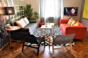 A seating area at Apartment Park Ribnjak