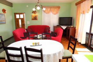 Posezení v ubytování Eridan apartment