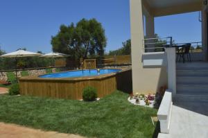 The swimming pool at or near M&M Villa