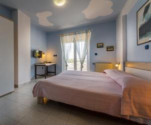 A bed or beds in a room at Apartments Borghese