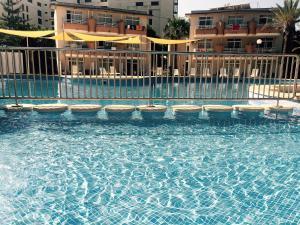The swimming pool at or near Club Sa Coma