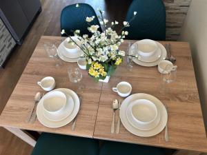Restoran või mõni muu söögikoht majutusasutuses Romeo Family Apartments