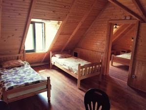 A bed or beds in a room at Deluxe Chalet in Ada Bojana