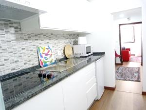 A kitchen or kitchenette at Embaixador, 70