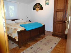 A bed or beds in a room at Apartments Ivancevic