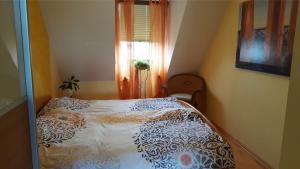 Ein Bett oder Betten in einem Zimmer der Unterkunft Ferienwohnung Nähe Messe und Uni Augsburg