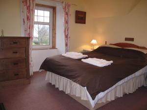 A bed or beds in a room at Glashven