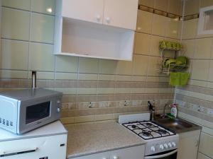 Кухня или мини-кухня в Apartment on Sovetskaya 21