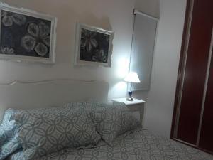 """Una cama o camas en una habitación de """"Los Abrojos"""" 2"""
