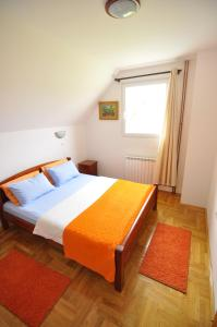 A bed or beds in a room at Apartments Millenium