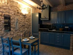 A kitchen or kitchenette at Holiday Homes Susak Sansego