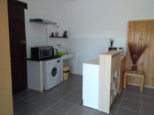 A kitchen or kitchenette at loft At Besset