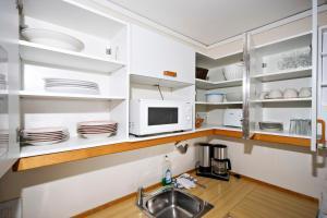 A kitchen or kitchenette at Åros Feriesenter