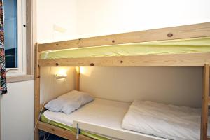 A bunk bed or bunk beds in a room at Åros Feriesenter