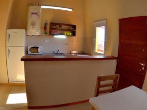 Una cocina o kitchenette en Dulce Naranja